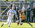 Tom Walsh evades a tackle by ex-Son Andy Graham 21