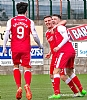 Calum Gallagher and Bobby Barr help Dom Thomas celebrate 9